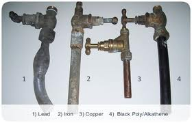 Image of different pipes - lead, iron, copper, black poly/alkahene