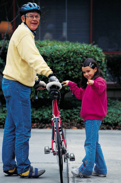 Granddad and granddaughter with bicycle