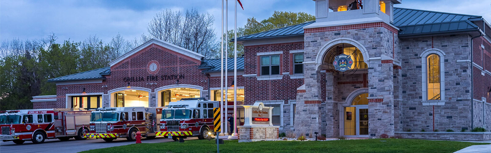 Photo of Orillia Fire Station One with fire trucks in foreground.