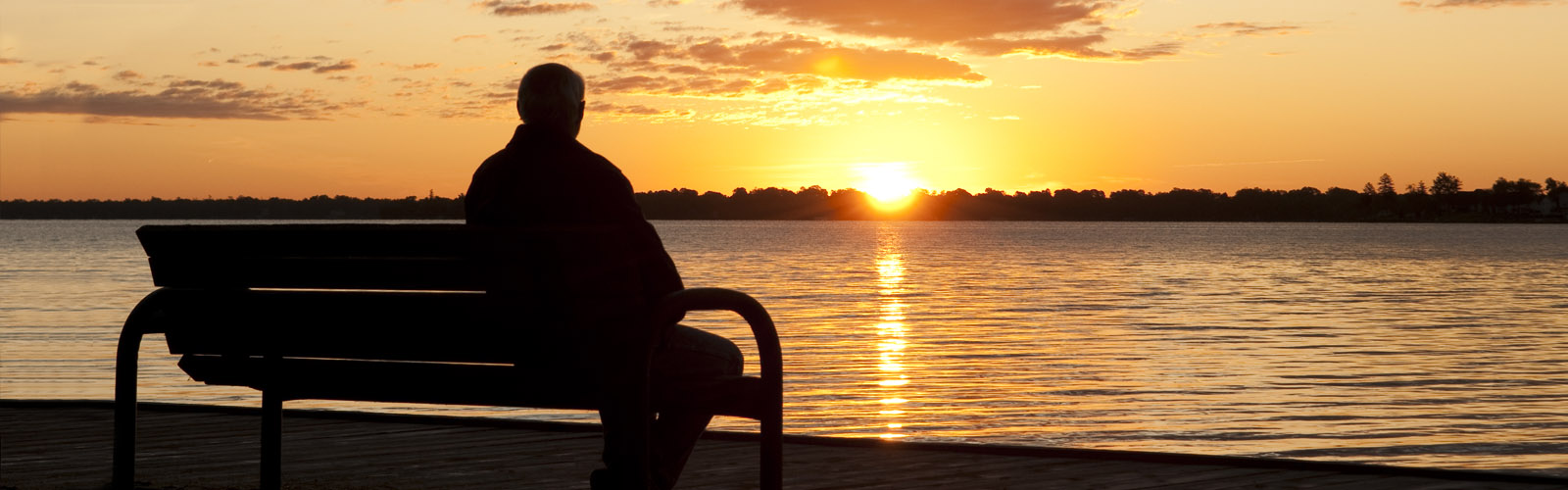 Man on bench at sunset