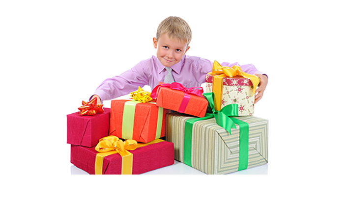 Boy holding Christmas presents